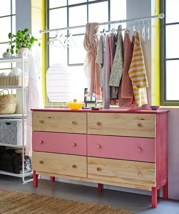 IKEA bedroom idea with a long idea dresser with DIY clothing rack hung above it