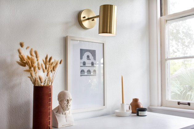 Cylindrical minimalist lighting sconce with work desk