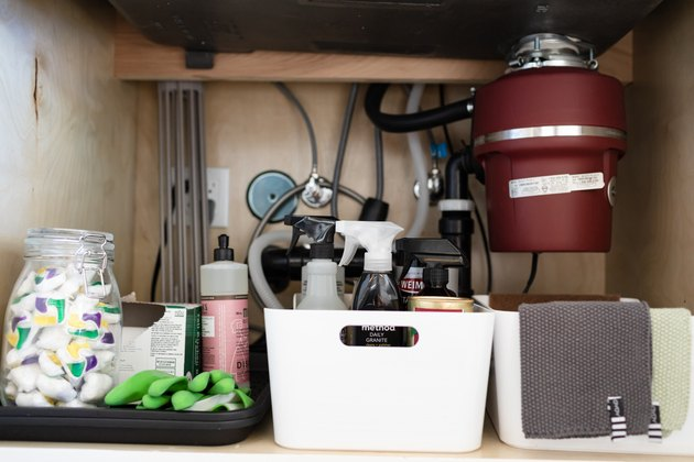 garbage disposal and organized under kitchen sink