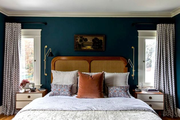 rattan and wood bed, teal walls