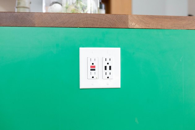 close up of kitchen electric outlet on green background