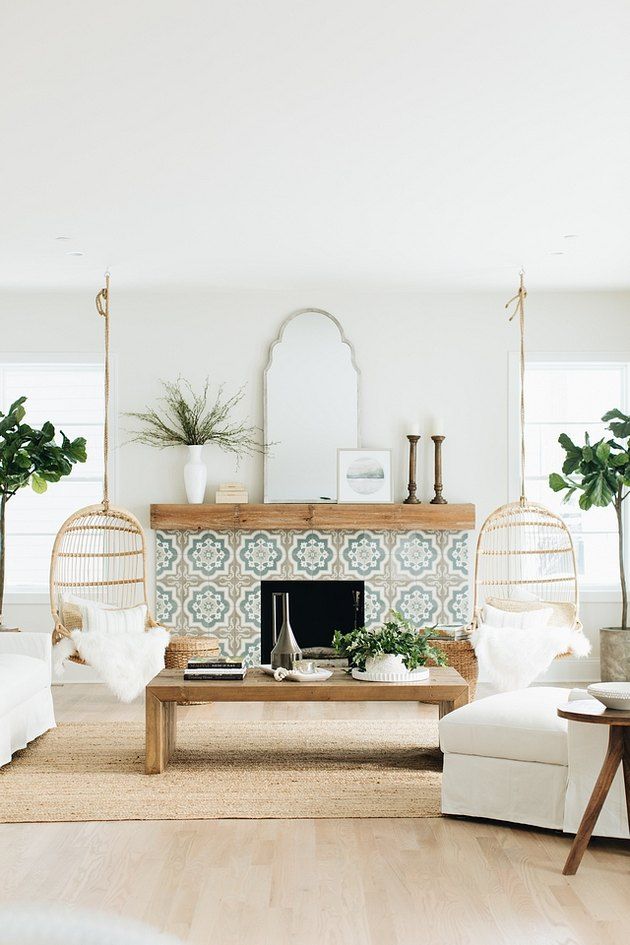 boho coastal living room with rattan swings, moroccan tiled fireplace