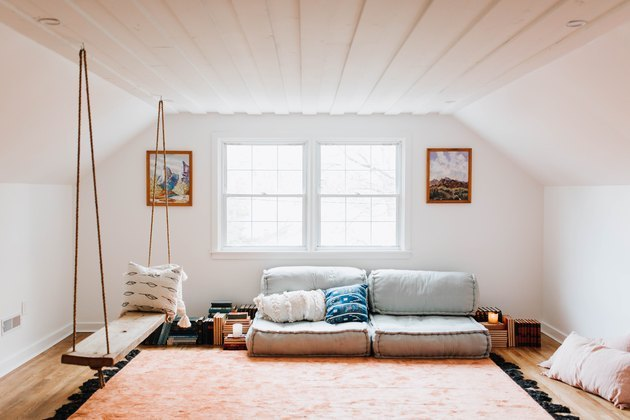 cozy attic with floor seating and swinging rope bench