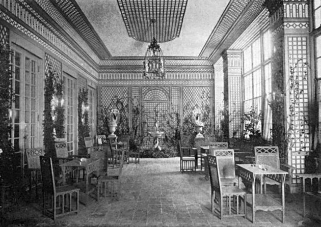 black and white photograph of an interior with tables and chairs