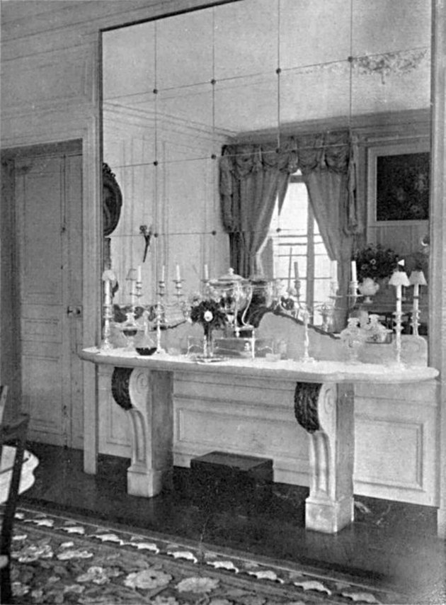 black and white photograph of room with large mirror wall