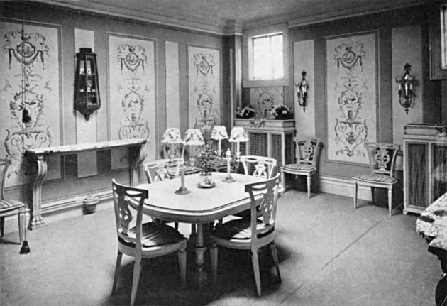 black and white photograph of a dining room interior with patterned walls