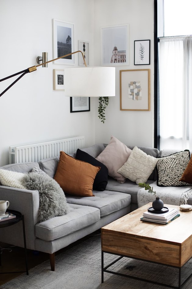 cozy living room corner idea with sofa and artwork