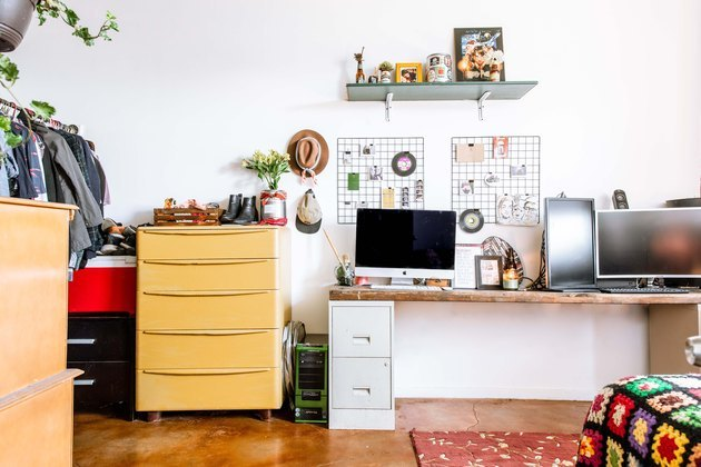 colorful bedroom desk area with storage and hanging shelf