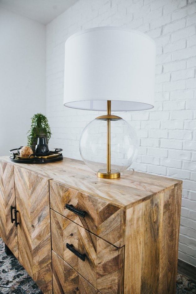 Minimalist lighting clear glass table lamp with wooden dresser