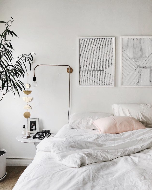 white bedroom ideas with modern artwork