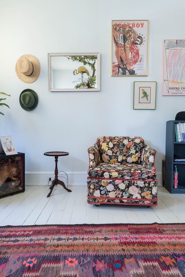 eclectic seating area with grandma style chair and mosaic picture wall