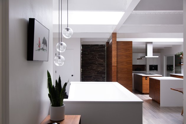 modern kitchen island with three pendant lights hanging above