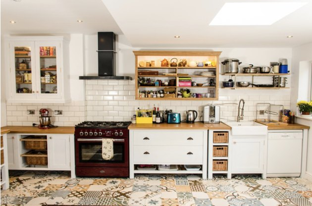 vibrant kitchen floor tile patterns in kitchen with white counters and subway tile backsplash