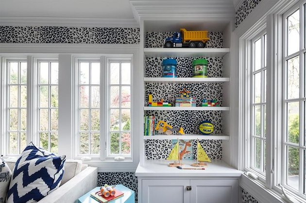 animal print modern wallpaper in family room with white molding
