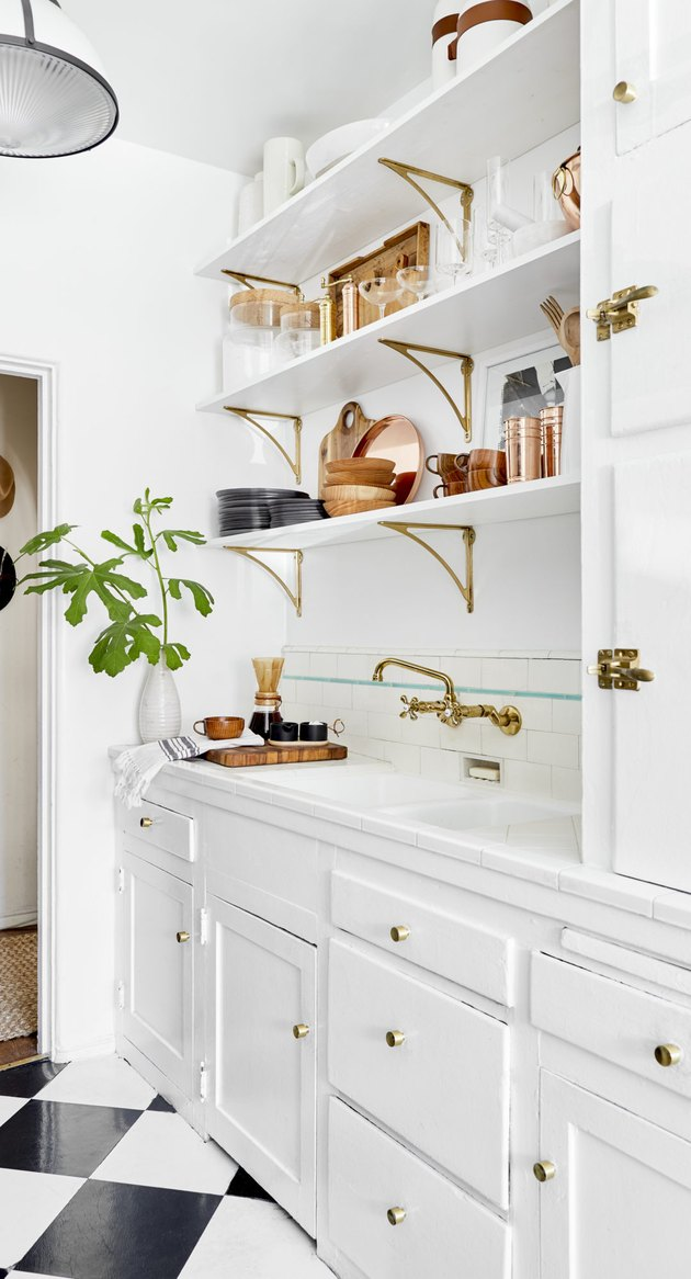 arts and crafts interior with white kitchen with floating shelves