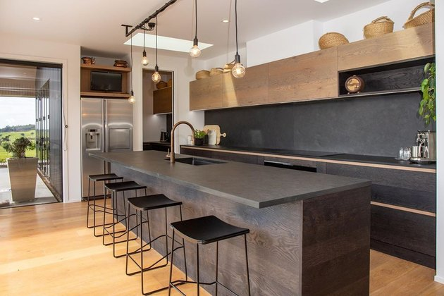 Modern kitchen with slate countertops and a slate backsplash