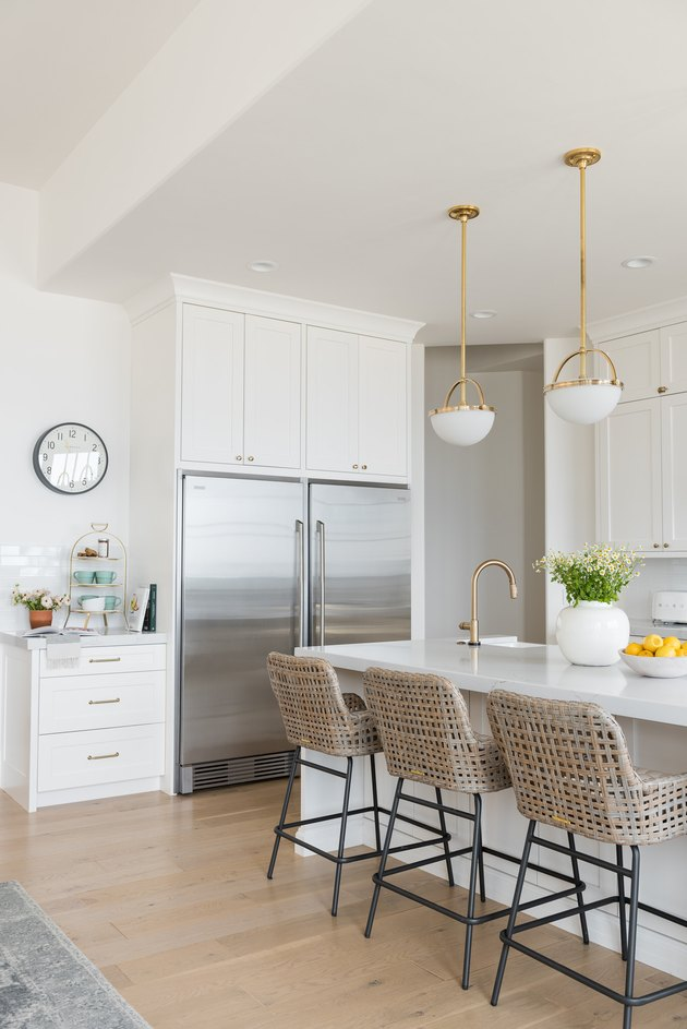 white contemporary kitchen island ideas with seating and woven counter stools