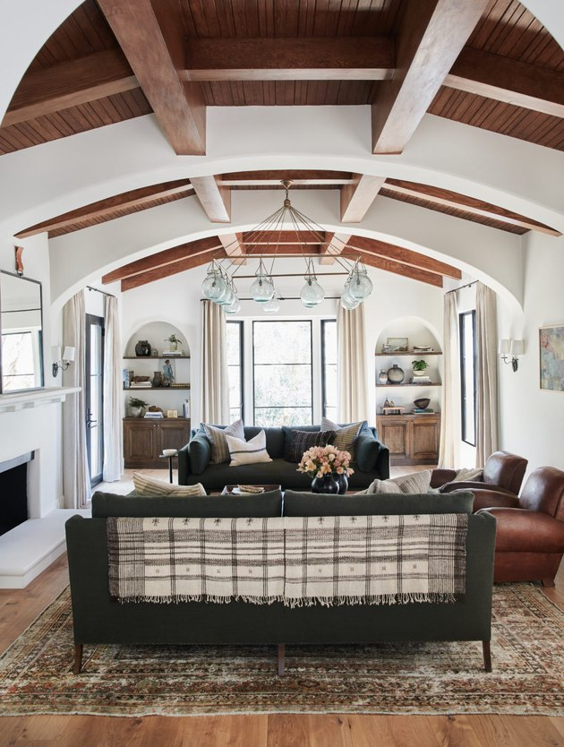 white traditional living room with wooden beams and two sofas
