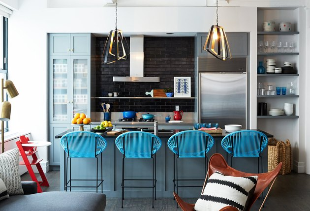 small kitchen idea with blue cabinets and black tile backsplash