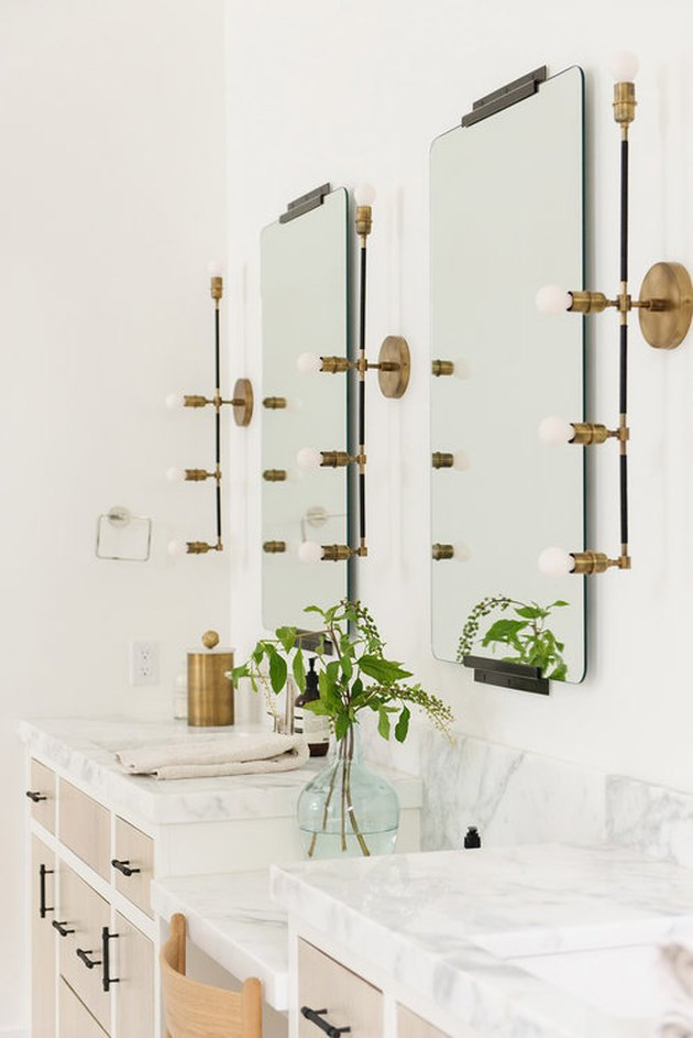 Industrial bathroom mirror lighting ideas above a marble bathroom vanity