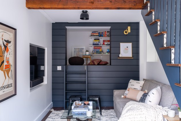 rustic basement ideas with with dark blue shiplap and colorful wall art