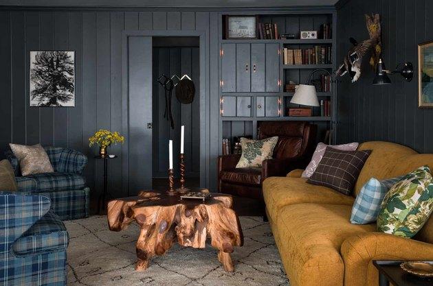 dark blue rustic basement ideas with mustard sofa