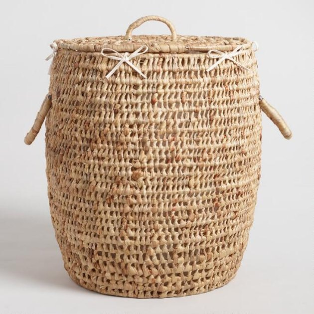 Woven circular laundry hamper with handles and lid