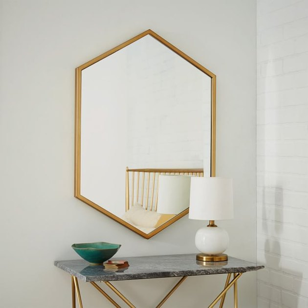 Oval hexagonal wall mirror with brass border