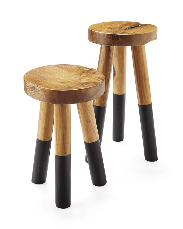 Decorative wooden stools with lower half of legs dipped in black paint