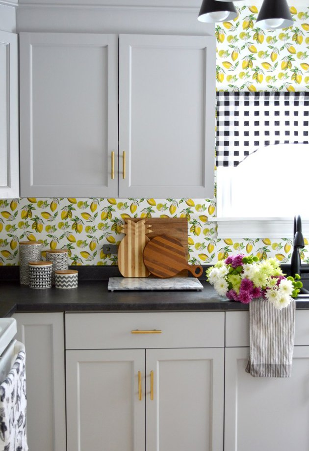 kitchen wallpaper idea  with lemon print on backsplash and white cabinets
