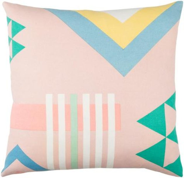 Pale pink-dominant geometric throw pillow with different sherbert-colored accents