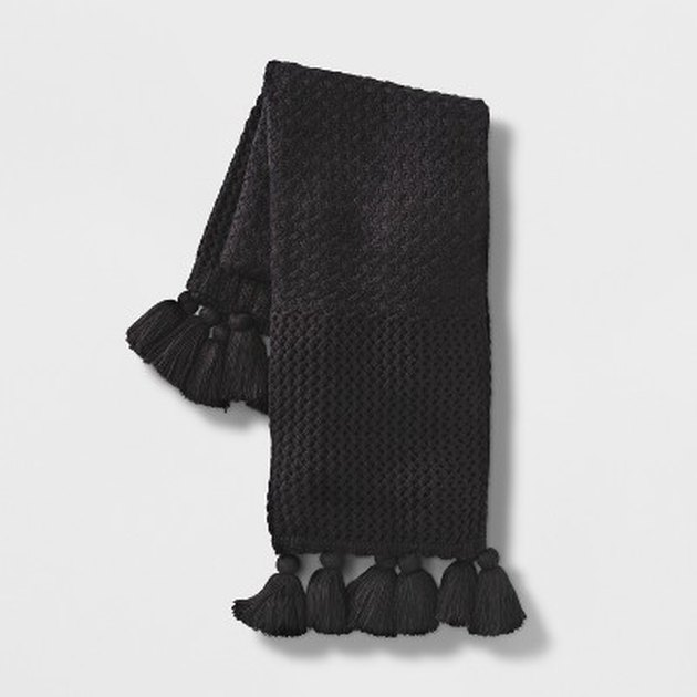 Solid black throw blanket with tassels