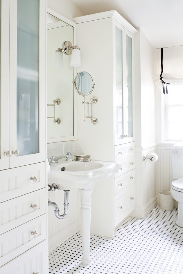 white bathroom idea with mosaic floor tile and pedestal sink