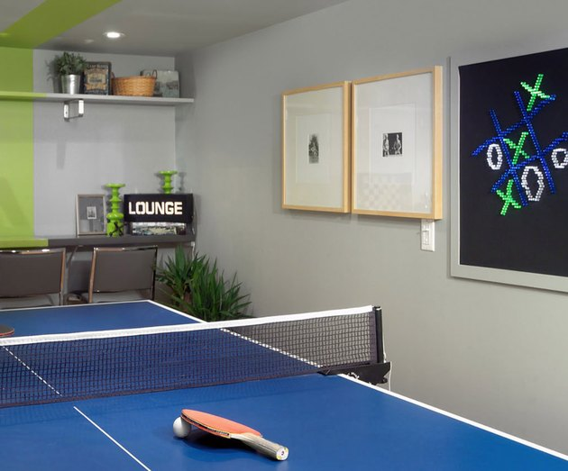basement game room ideas with blue ping pong table, and chalkboard