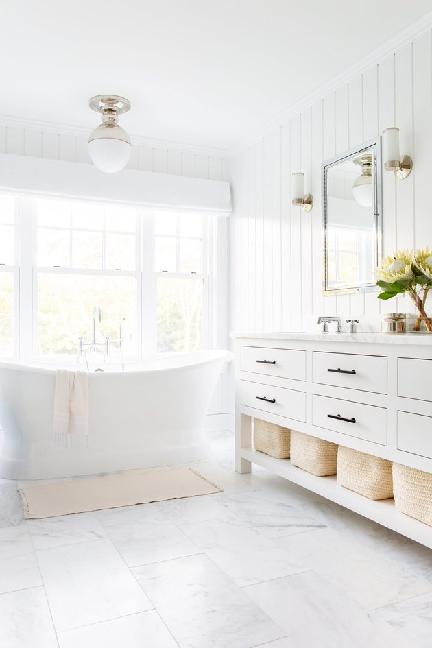 white bathroom idea with tongue and groove wall paneling and freestanding tub
