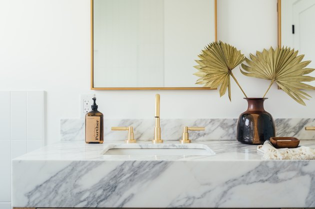 Dried palm plants on bathroom counter