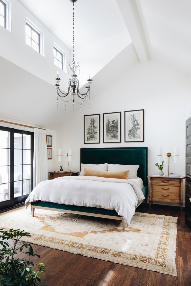 Traditional bedroom with chandelier and vintage rug