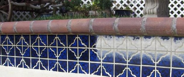 Swimming pool tile, half clean and half with calcium build up