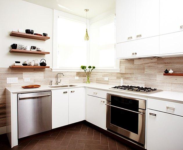 modern kitchen with oversized travertine backsplash