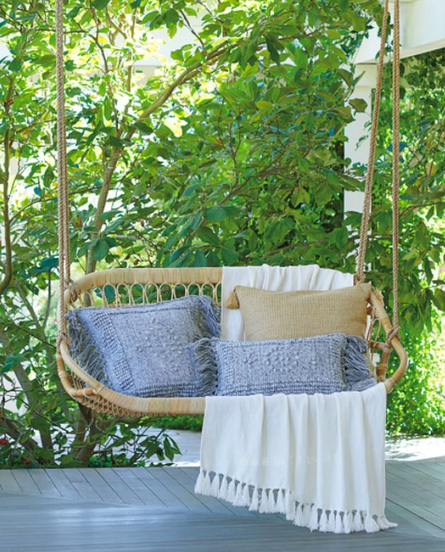 Outdoor hanging swing for two pillows and blankets