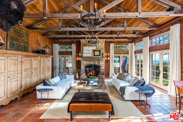 living room area with exposed beam ceiling