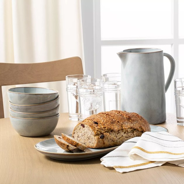 table with bowls, pitcher, and bread