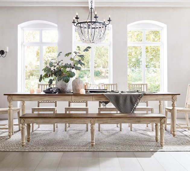 white traditional dining room with wooden table