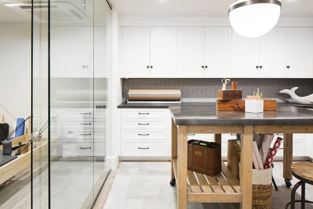 basement apartment kitchen with glass wall and island
