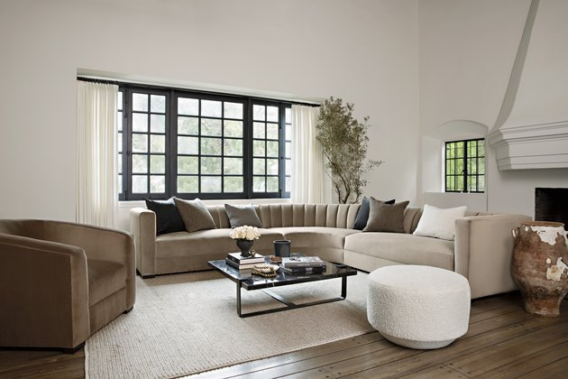 sectional sofa and tub chair with round ottoman in living room by Nate Berkus and Jeremiah Brent for Living Spaces