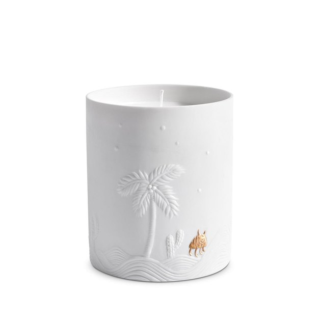 white and gold candle with palm tree motif