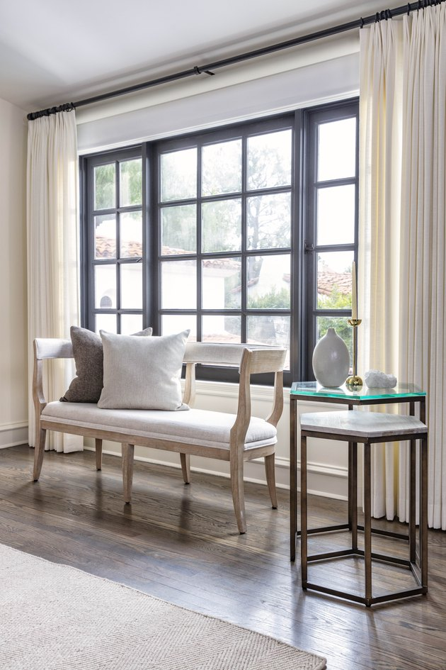 bench with wood frame in front of window by Nate Berkus and Jeremiah Brent for Living Spaces