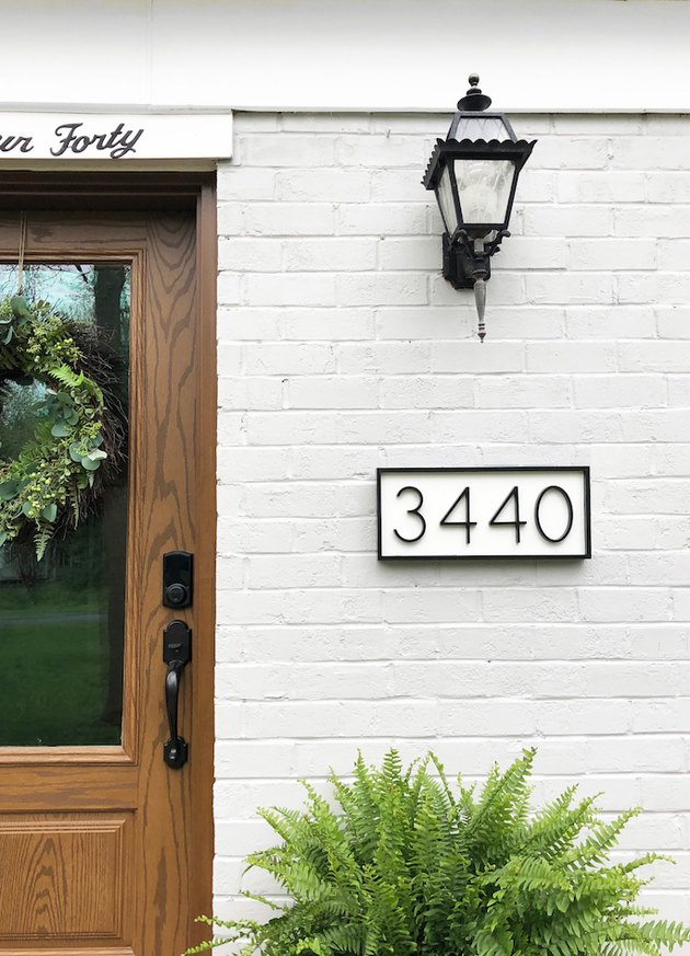 DIY house number sign with white background and black numbers