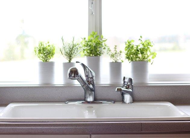 kitchen window idea with DIY herb garden in cans