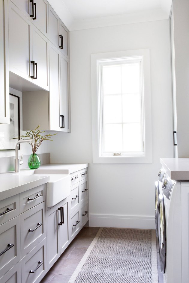 Taupe color paint in small laundry room with farmhouse sink